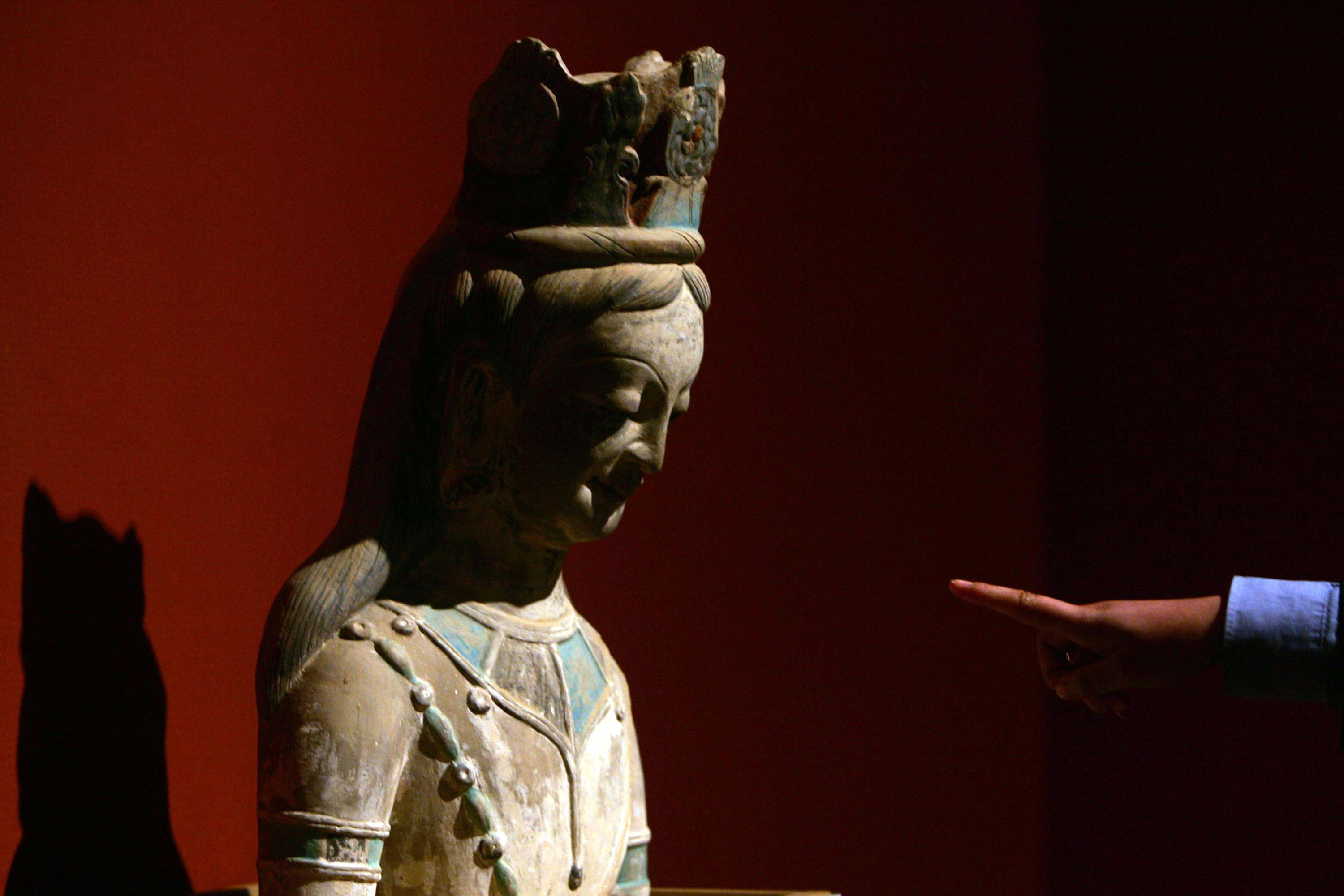 Hidden treasure: ancient buddhist statue contains hoard of artifacts