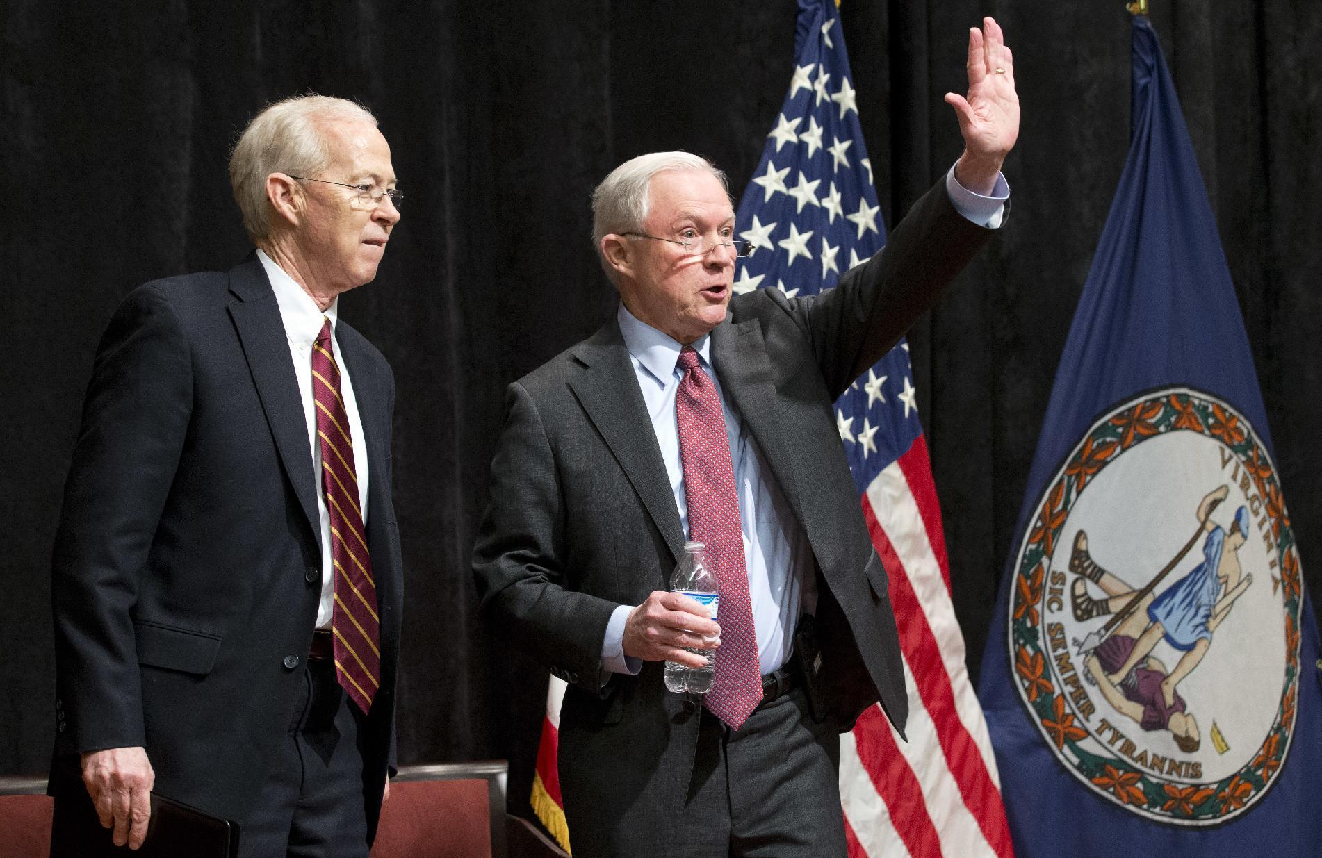 Attorney General Jeff Sessions, right, accompanied by Deputy Attorney General Dana Bonte, waves after speaking to law enforcement officers in Richmond, Va., Wednesday, March 15, 2017. (AP Photo/Steve Helber)