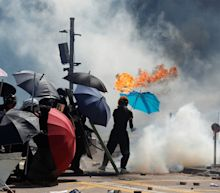 Hong Kong police officer hit by arrow in clashes with protesters