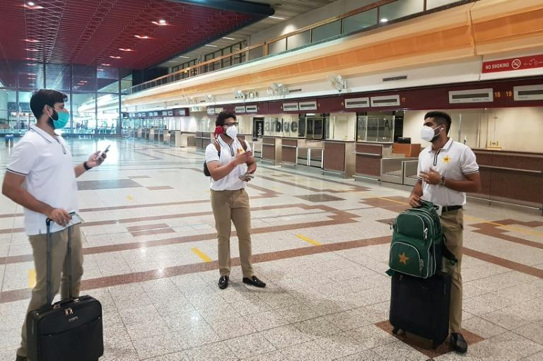 Pakistan cricketers Babar Azam (right), Imad Wasim (left) and Imam-ul-Haq (centre) arrive to check in at the Allama Iqbal International airport in Lahore before their departure for England (AFP Photo/Handout)