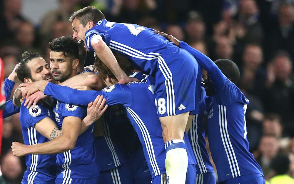 Chelsea players celebrate on Tuesday night - Rex Features