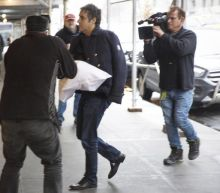 Michael Cohen seen clutching pillow with arm in sling as reports say Trump ordered him to lie to Congress