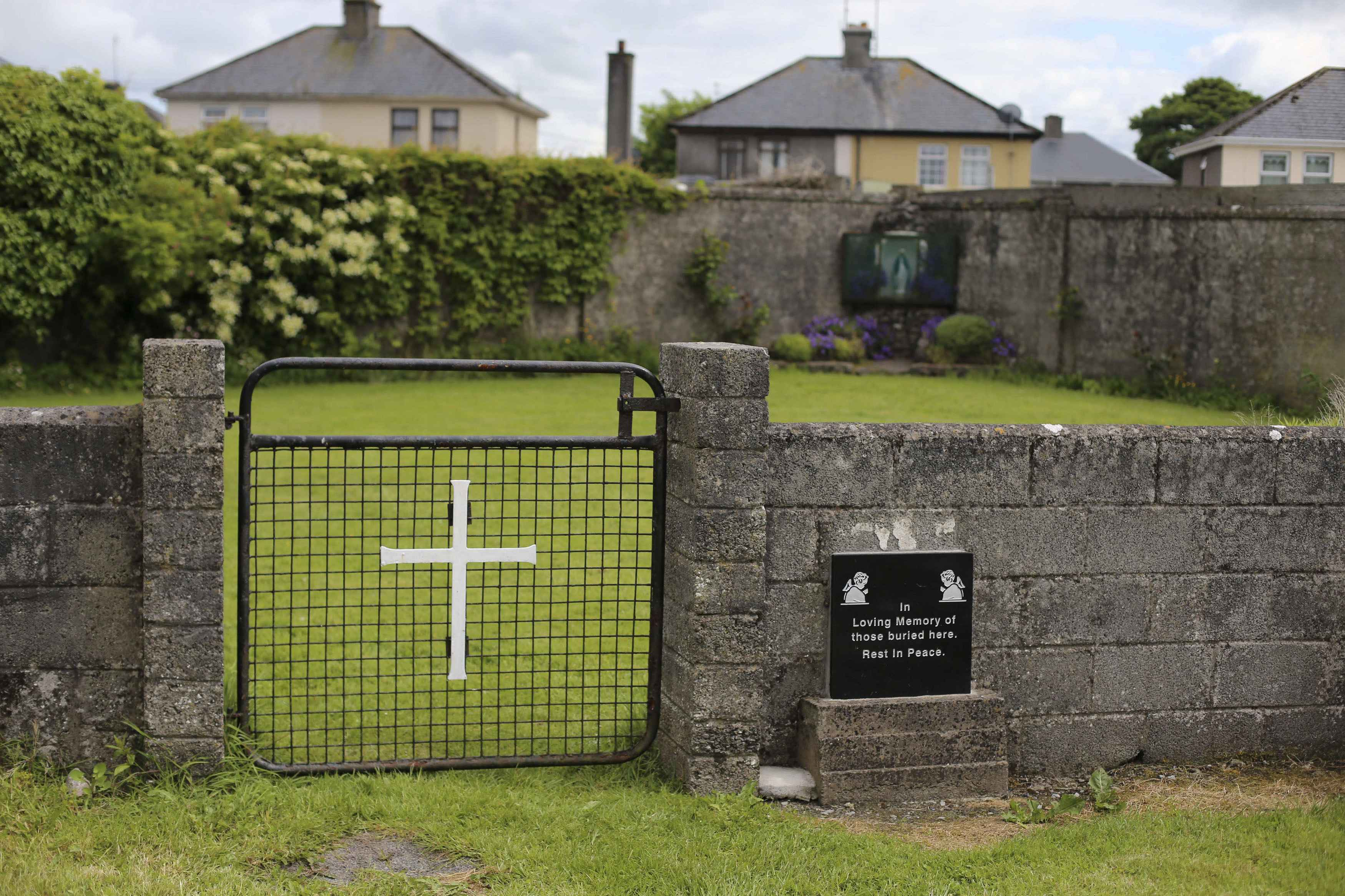 The entrance to the site of a mass grave of hundreds of children who died in the former Bons Secours home for unmarried mothers is seen in Tuam, County Galway June 4, 2014. Local residents on Tuesday said they hoped a campaign is making headway to commemorate the unmarked mass grave of nearly 800 babies found in Tuam. The infants were buried without coffins in the grounds of a former home for unmarried mothers between 1925 and 1961. A total of 796 babies toddlers and children were buried in this mass grave. Death records show the children died from malnutrition and infectious disease. REUTERS/Stringer (IRELAND - Tags: OBITUARY HEALTH)