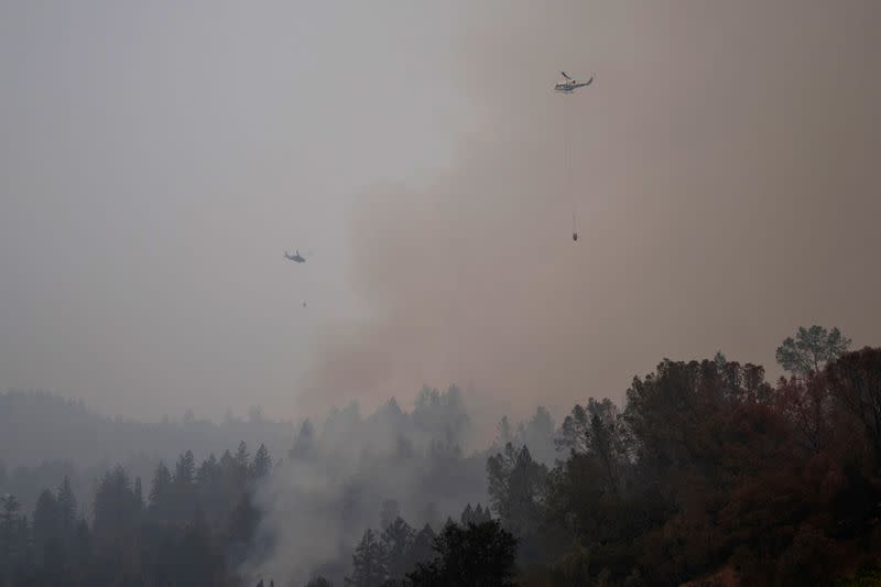 Helicopters prepare to drop water on the Glass Fire in Calistoga, California