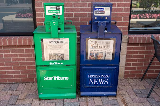 Maple Grove, Minnesota - July 21, 2019: Newspaper vending machine kiosks for the StarTribune and St Paul Pioneer Press, the two major daily papers in Twin Cities area