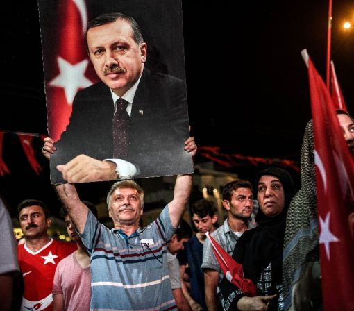 Defiant Turkey extends police powers, shutters schools after coup