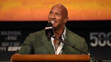 Dwayne 'The Rock' Johnson shares smiling photo with every XFL helmet after buying the league