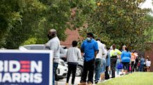 """""""I would have waited all day if I had to"""": Hours-long lines mar first day of early voting in Georgia"""