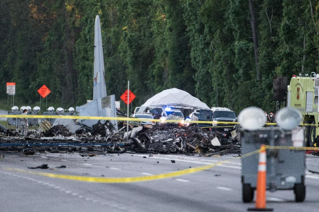 Wreckage is strewn across a Georgia road after a WC-130 cargo plane crashed last week, killing nine