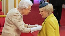 Coronavirus: Queen wears long gloves while handing out honours to members of the public