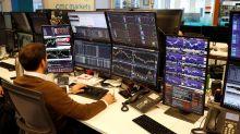 London's FTSE 100 subdued, IWG lifts midcaps