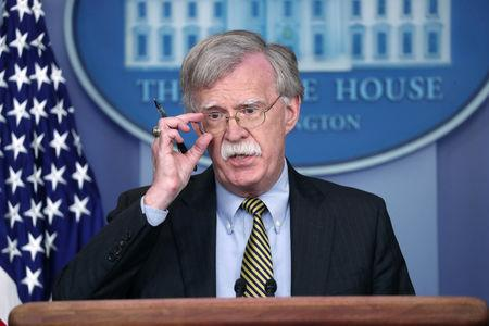 U.S. National Security Advisor John Bolton answers questions from reporters as he announces that the U.S. will withdraw from a treaty with Iran during a news conference in the White House briefing room in Washington, U.S., October 3, 2018. REUTERS/Jonathan Ernst