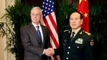 US, China defence chiefs aim to improve strained ties