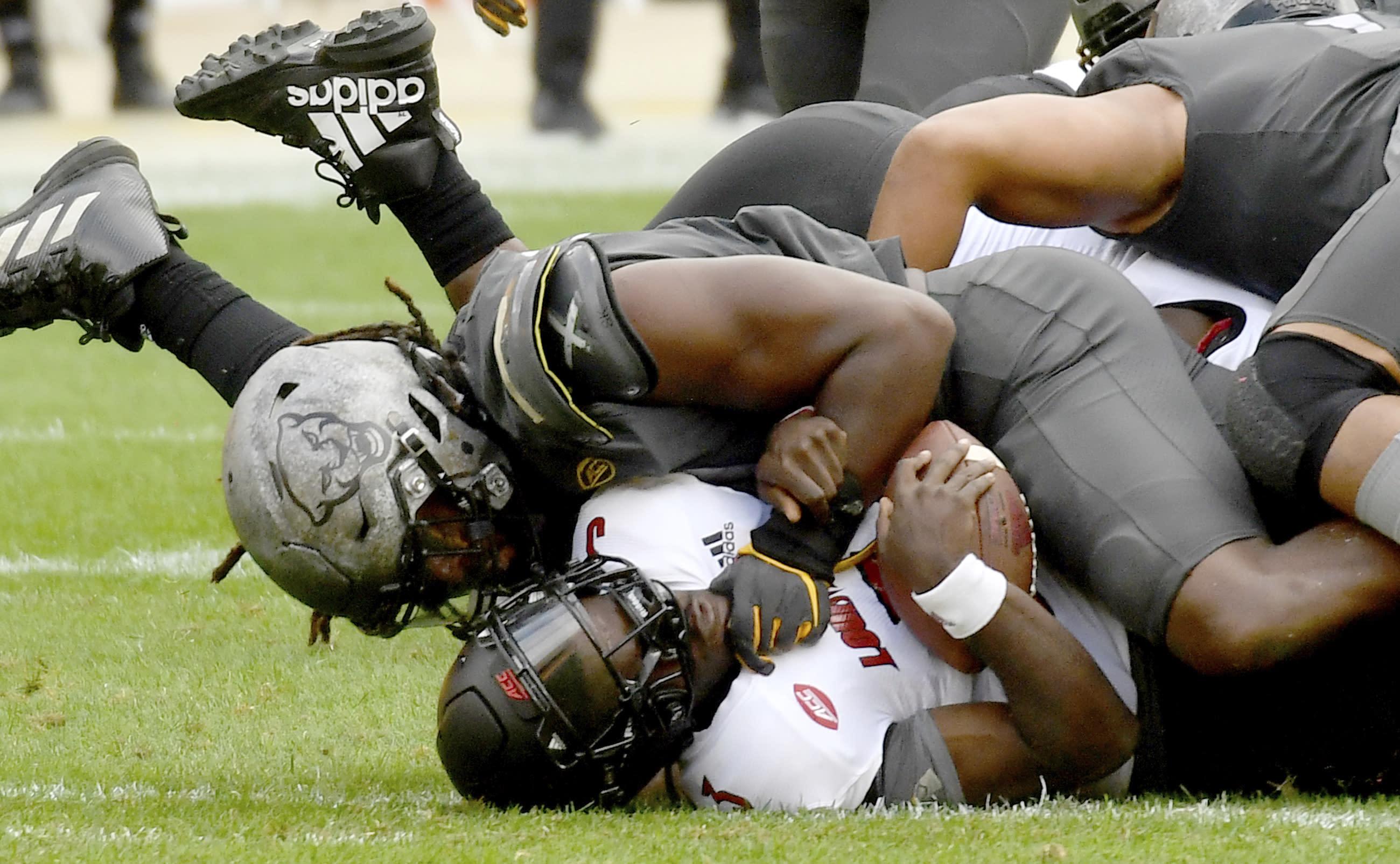 Pittsburgh defensive lineman Patrick Jones II sacks Louisville quarterback Malik Cunningham in the third quarter during an NCAA college football game at Heinz Field, Saturday, Sept. 26, 2020, in Pittsburgh. (Matt Freed/Pittsburgh Post-Gazette via AP)
