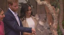 Prince Harry and Meghan charm kids and koala at Taronga zoo