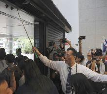 Protesters block Hong Kong building access, plan new action
