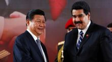 China stays on the sidelines as Venezuela spirals downward