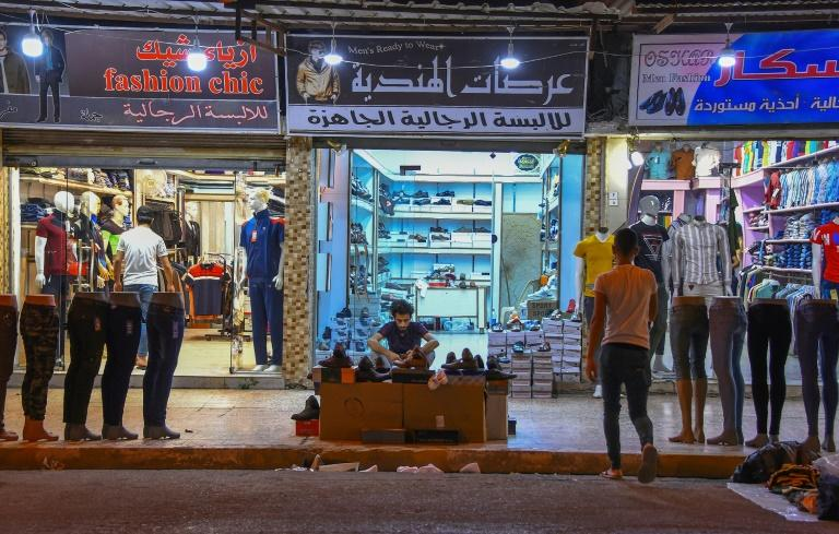 Iraqis local businesses have long struggled to compete with cheap Turkish, Iranian or Chinese imports (AFP Photo/Zaid AL-OBEIDI)