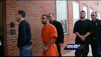 4 charged in triple homicide appear in court