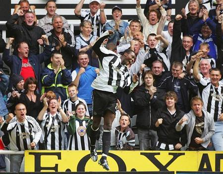 Newcastle United's Ameobi celebrates scoring winning goal against Wigan Athletic during English Premier League soccer match in Newcastle