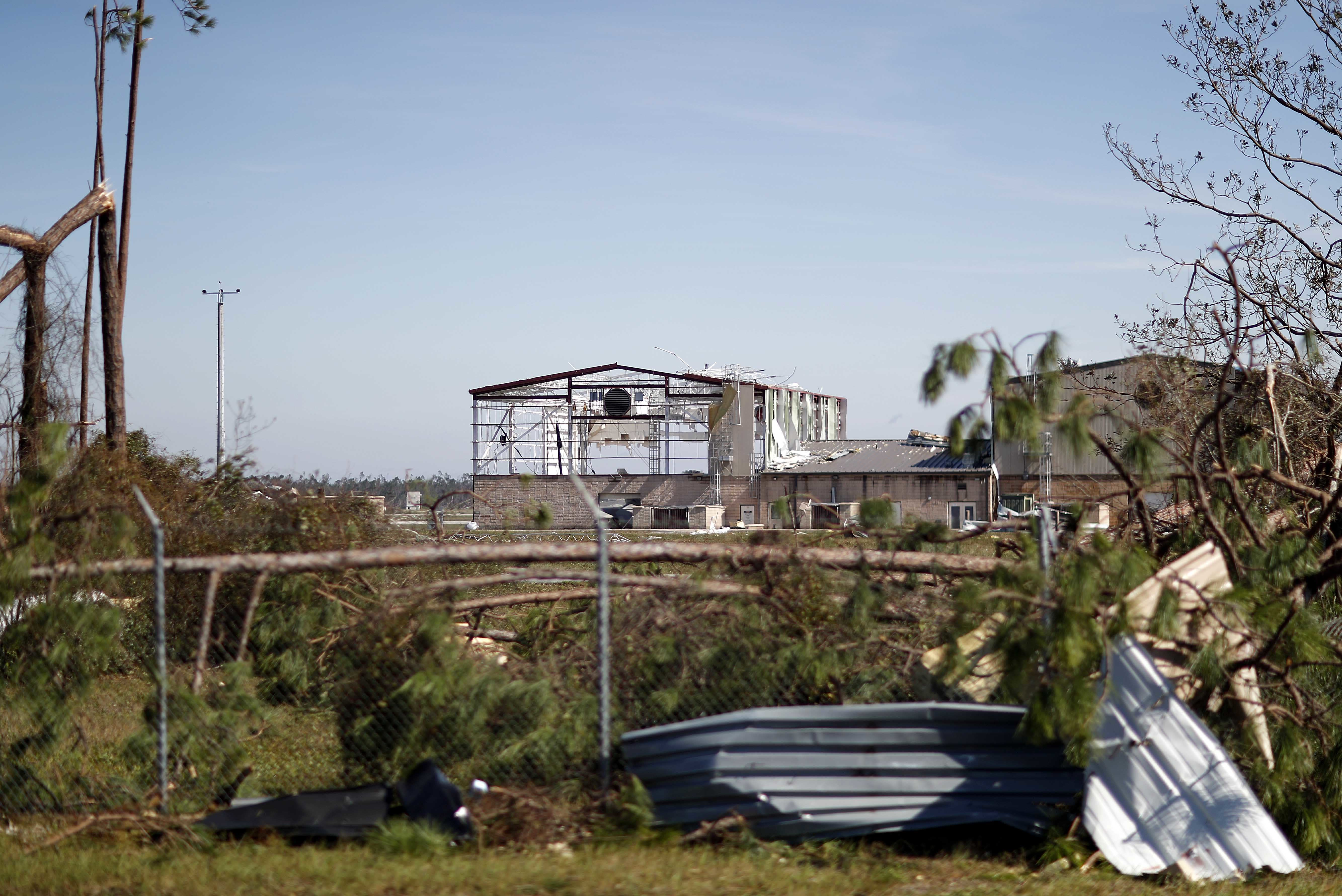 An airplane hanger at Tyndall Air Force Base is damaged from hurricane Michael in Panama City, Fla., Thursday, Oct. 11, 2018. The devastation inflicted by Hurricane Michael came into focus Thursday with rows upon rows of homes found smashed to pieces, and rescue crews began making their way into the stricken areas in hopes of accounting for hundreds of people who may have stayed behind. (AP Photo/David Goldman)