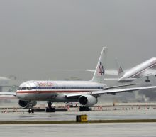 Today's charts: American Airlines gains on Qatar Airways investment interest; Staples jumps on buyout talk; Tesla in talks with China