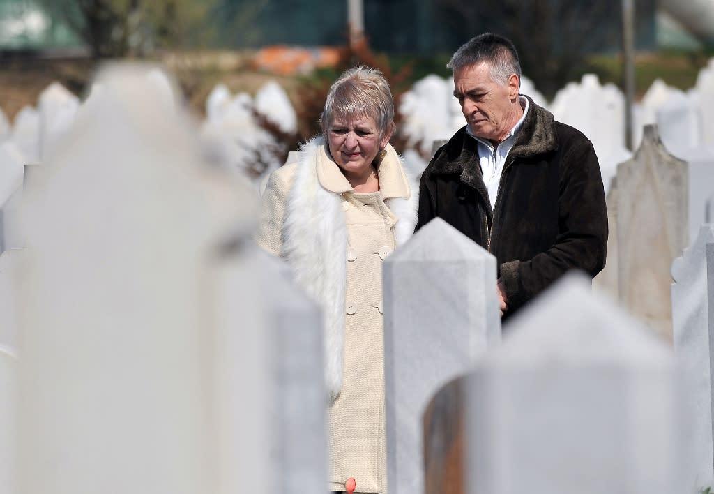 Edin Salkic (right) and Sefika Salkic, whose son Fedja was killed in the siege of Sarajevo, visit his grave in the city (AFP Photo/Elvis Barukcic)