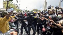 Thai democracy protesters march despite police, rival groups