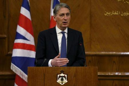 Britain's Foreign Secretary Philip Hammond speaks during a joint news conference with Jordan's Foreign Minister Nasser Judeh at the Foreign Ministry in Amman, Jordan