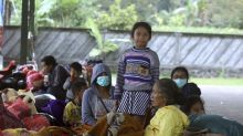 Evacuations from Bali volcano swell to about 50,000