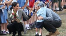 Adorable boy bear-hugs Meghan Markle, tugs at Prince Harry's beard on couple's royal Australia tour