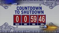 Government teeters on brink of shutdown amid health care law challenge