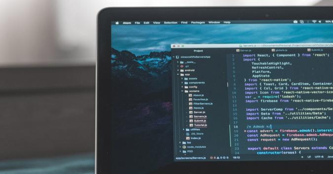 Stock image of a MacBook running code.