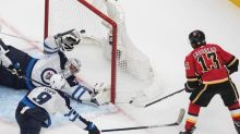 Flames ground Jets 4-1 to take series lead, Winnipeg's Scheifele injured