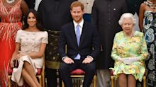 Meghan Markle's cross-legged pose at the Queen's Young Leaders Awards divides royal fans