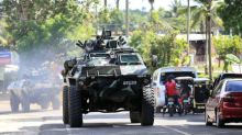 Manila deploys commandoes, helicopters to retake city from Islamists