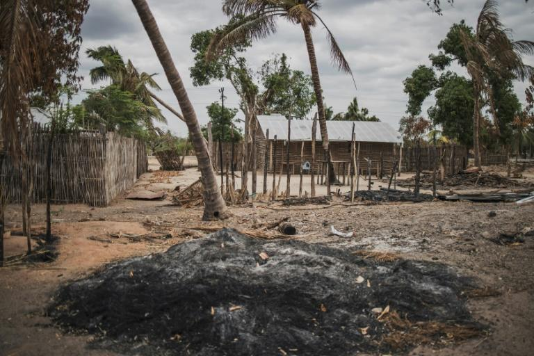 A mound of ashes is seen in the recently attacked village of Aldeia da Paz outside Macomia, Mozambique, on August 24, 2019 (AFP Photo/MARCO LONGARI)