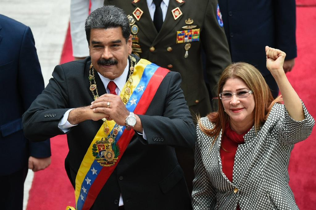 Venezuelan President Nicolas Maduro and his wife Cilia Flores (AFP Photo/Federico Parra )