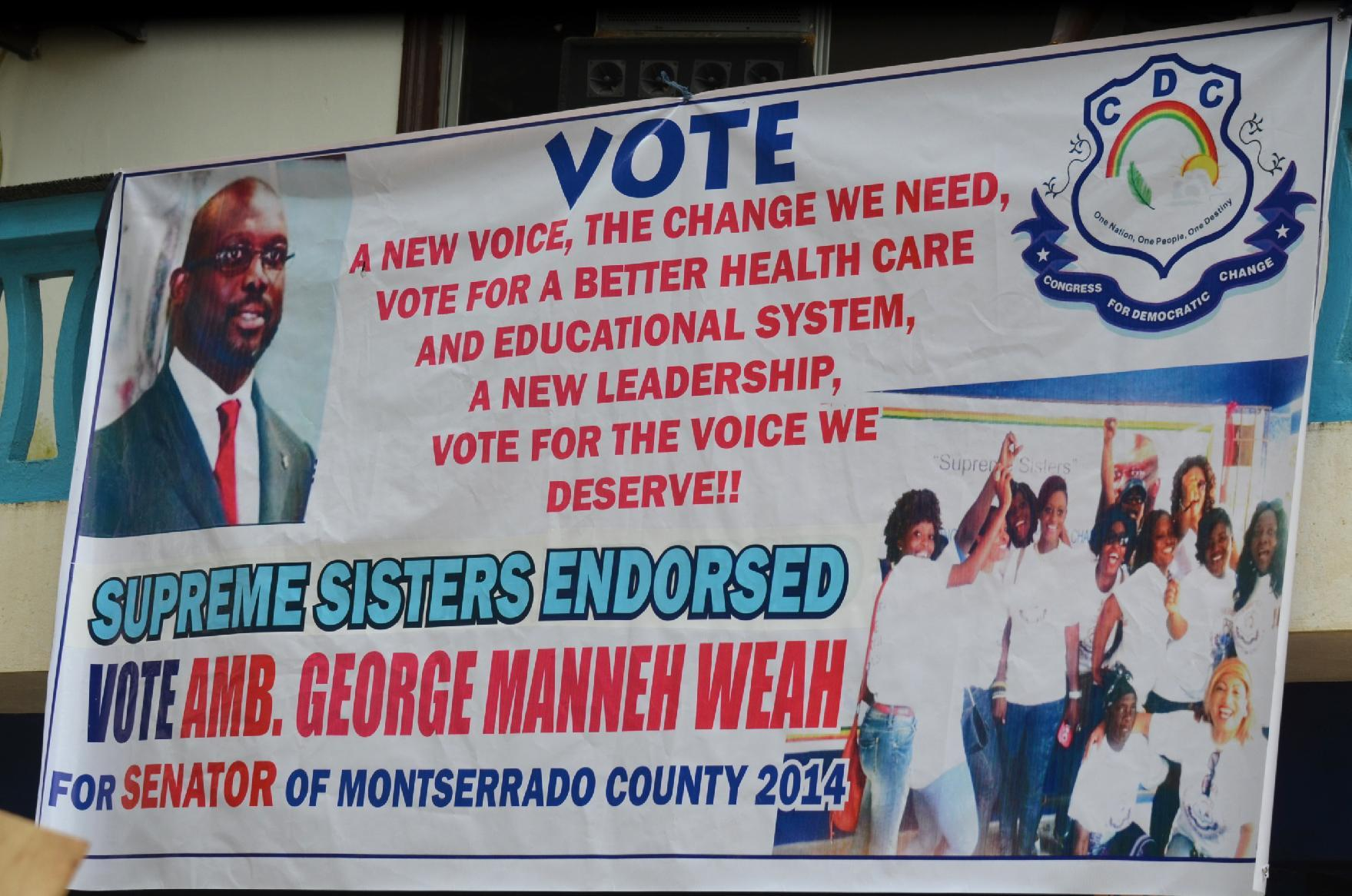 A campaign poster for retired footballer George Weah, one of 139 candidates in elections to Liberia's Senate (AFP Photo/Zoom Dosso)