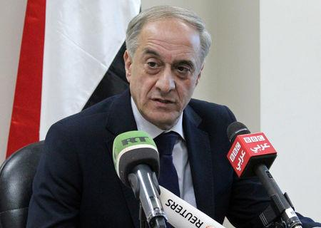 Ayman Sousan, Assistant Syrian Foreign Minister, talks to journalists in Damascus