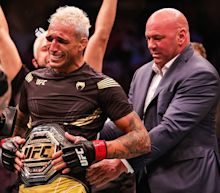 Charles Oliveira mounts epic comeback to claim lightweight title