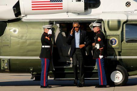 Obama arrives aboard the Marine One helicopter to depart O'Hare International Airport in Chicago