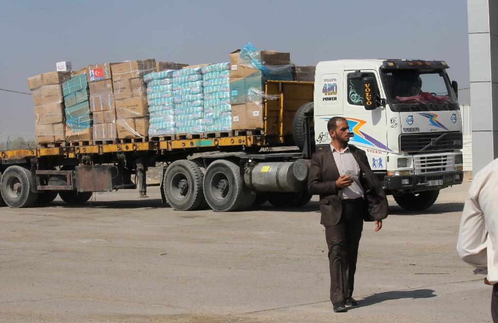 A truck loaded with aid parcels provided by Turkey waits at the Kerem Shalom crossing near Rafah after it entered the southern Gaza Strip from Israel on July 4, 2016