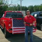 'God, Guns and Freedom': Ford dealership giving customers free Bible, shotgun and American flag