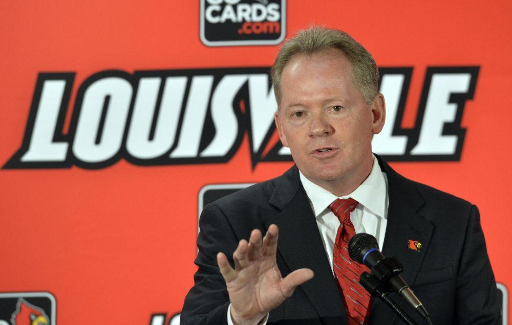 Louisville hires Petrino again as football coach