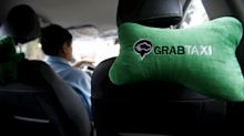 Asia's Taxi Companies Give Banks Real Competition: Adam Minter
