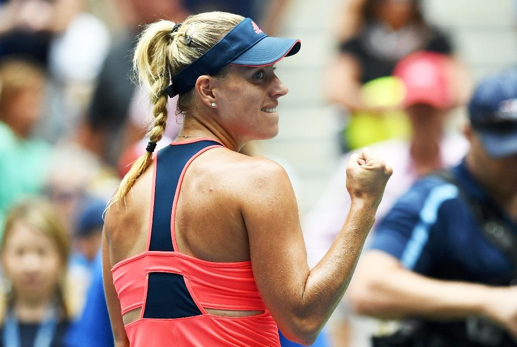 Angelique Kerber of Germany reacts pumps her fist after winning against Roberta Vinci of Italy during their 2016 US Open Women's quarterfinals match in New York on September 6, 2016 (AFP Photo/Jewel Samad)