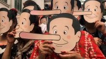 Thai activists in Pinocchio masks call junta leader 'liar'