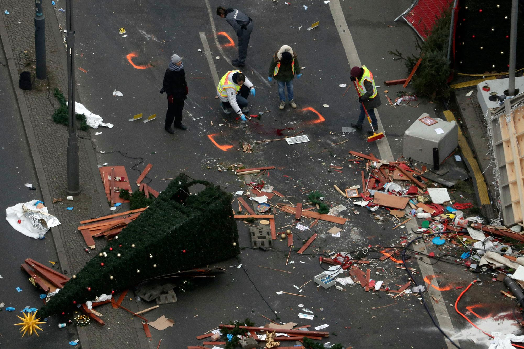 <p>Police officers inspect the crime scene in Berlin, Germany, Tuesday, Dec. 20, 2016, the day after a truck ran into a crowded Christmas market and killed several people. (AP Photo/Markus Schreiber) </p>