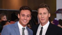 Tom Daley and husband Dustin Lance Black release first photos of their baby boy